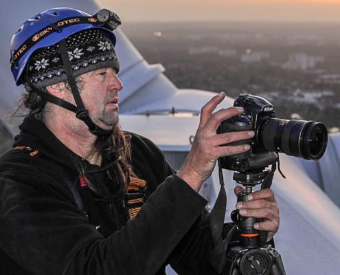 Der Fotograf Jan Oelker bei der Arbeit auf einer NM 92 in Hamburg